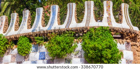 Mosaic Fence at the Parc Guell designed by Antoni Gaudi located on Carmel Hill, Barcelona, Spain. - stock photo