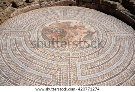Mosaic floors of ancient roman villas with scenes from Greek mythology - battle of Theseus and Minotaur in labyrinth ,archaeological park Tombs of Kings,Paphos,Cyprus,unesco heritage