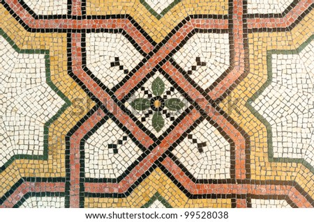 mosaic floral pattern on church floor - stock photo