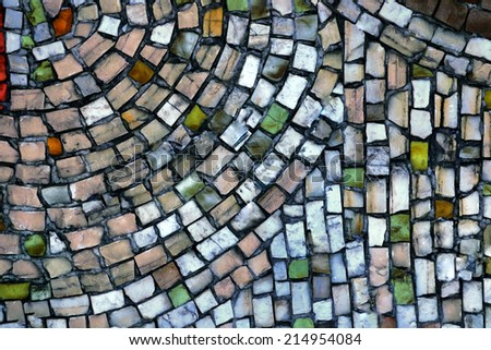 mosaic of small stones on the wall - stock photo