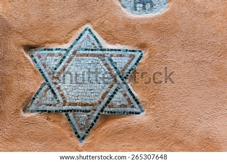 Mosaic of Star of David on the wall of Roman Ghetto house - stock photo