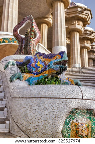 mosaic salamander at the entrance of Parc Guell designed by Antoni Gaudi located on Carmel Hill, Barcelona, Spain. - stock photo