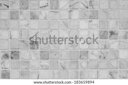 Mosaic square tiles pattern of the wall, black and white. - stock photo