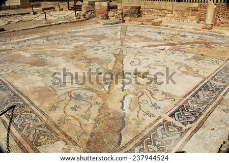 Mosaic tile floor ruins in Caesarea Maritima National Park, a city and harbor built by Herod the Great about 25-13 BC. The archaeological ruins are on the Mediterranean coast of Israel. - stock photo