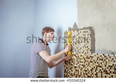 mosaic tiles, repair - stock photo