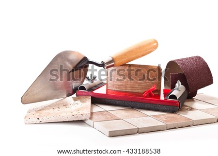 Mosaic tiles, trowel, tool for grinding walls, sandpaper on a white background
