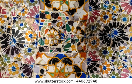 Mosaic wall at Parc Guell in Barcelona, Spain. Colorful ceramic tiles. - stock photo