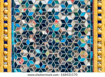 Mosaic wall decorative ornament from colorful glass - stock photo