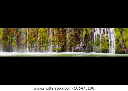 Mosbrae Falls outside Dunsmuir, California flows year round from natural springs and is always green. - stock photo