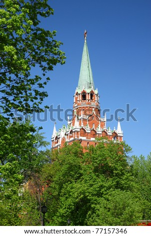 Moscow. Alexander Garden. Type the Kremlin towers due to the thick foliage of trees. - stock photo