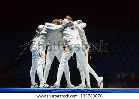 MOSCOW - APR 6: Athletes embrace in competitions on championship of world in fencing among juniors and cadets, in Sports Olympic complex, on April 6, 2012 in Moscow, Russia - stock photo