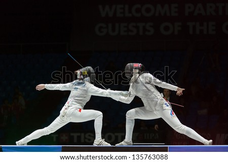 MOSCOW - APR 6: Beautiful fight on championship of world in fencing among juniors and cadets, in Sports Olympic complex, on April 6, 2012 in Moscow, Russia - stock photo