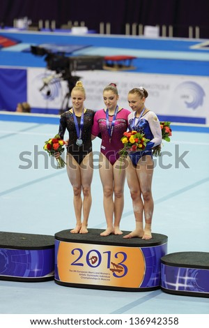 MOSCOW - APR 20: 2013 European Artistic Gymnastics Championships. Awarding of winners Uneven Bars - Aliya Mustafina, Jonna Adlerteg, Maria Paseka in Olympic Stadium on April 20, 2013 in Moscow, Russia
