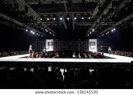 MOSCOW - APR 4: Models walk at podium in Gostiny Dvor during Volvo Fashion Week, April 4, 2012, Moscow, Russia. Gostiny Dvor is one of most mesmerizing historical buildings in Moscow. - stock photo