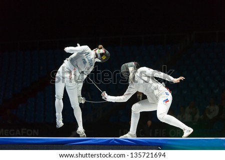 MOSCOW - APR 6: Neat trick of one of the athletes on championship of world in fencing among juniors and cadets, in Sports Olympic complex, on April 6, 2012 in Moscow, Russia - stock photo