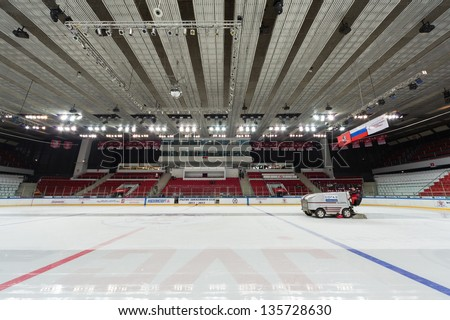 MOSCOW - APR 28: Preparation of ice for closing ceremony of the championship season of 2011-2012 Ice Hockey for Sports School, junior teams on April 28, 2012  in Sokolniki, Moscow, Russia. - stock photo