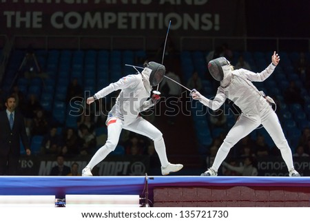 MOSCOW - APR 6: Serious clash on championship of world in fencing among juniors and cadets, in Sports Olympic complex, on April 6, 2012 in Moscow, Russia - stock photo
