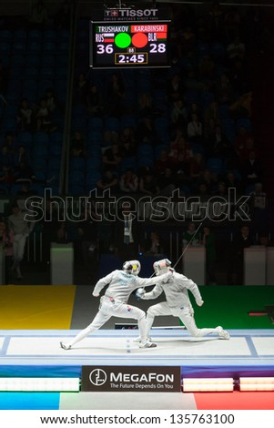 MOSCOW - APR 6: Trushakov and Karabinski compete  on championship of world in fencing among juniors and cadets, in Sports Olympic complex, on April 6, 2012 in Moscow, Russia - stock photo