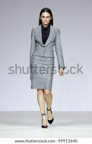 MOSCOW - APRIL 4: A model walks the catwalk during the show a collection of Valentin Yudashkin as part of Fashion Week, April 4, 2012, Moscow, Russia - stock photo