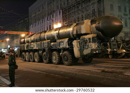 MOSCOW - APRIL 28: A Russian army Topol ballistic missile on a mobile rocket launcher drives in a street during a rehearsal for the Victory Day military parade, April 28, 2009 in Moscow, Russia.