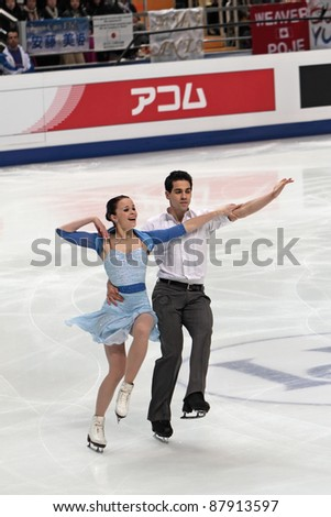 "MOSCOW - APRIL 30: Anna JoAnn Cappellini & Luca Lanotte compete in a pairs ice dancing routine during the 2011 World championship figure skating at the Palace of Sports ""Megasport"" on April 30, 2011 in Moscow, Russia. - stock photo"