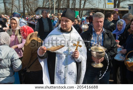 MOSCOW - APRIL 19: Church ceremony of consecration of Easter cakes and eggs for Easter Christ's in Russia. April 19, 2014, Moscow, Russia - stock photo