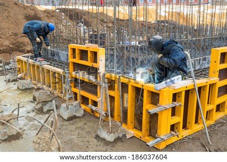 MOSCOW - APRIL 3: Construction site welders on april 3, 2014 in Moscow, Russia. Urban construction is at a faster pace in Russia. - stock photo