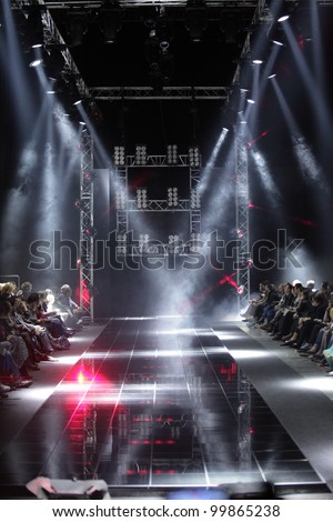 MOSCOW - APRIL 08: Creative lights on runway at the Dmitri Loginov Fall Winter 2012 runway presentation during Volvo Fashion Week on April 08, 2012 in Moscow, Russia - stock photo