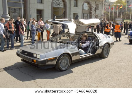 MOSCOW - APRIL 27, 2014: English retro car delorean on rally of classical cars, organized by Russian Club of Classical Autocars on Theatre square. - stock photo