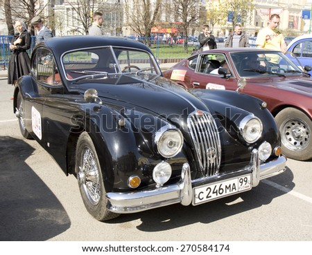 MOSCOW - APRIL 27, 2014: English retro car jaguar on rally of classical cars, organized by Russian Club of Classical Autocars on Theatre square.