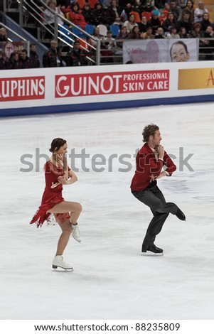 "MOSCOW - APRIL 30: Fabian Bourzat and Nathalie Pechalat compete in the pair ice dance at the 2011 World championship figure skating event at the Palace of sports ""Megasport"" on April 30, 2011 in Moscow, Russia. - stock photo"