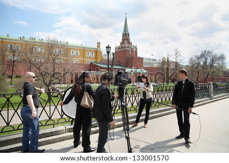 MOSCOW - APRIL 24: Group of journalists scene shot near Kremlin on April 24, 2012 in Moscow, Russia. Kremlin will take control of appointments to senior positions relatives of officials. - stock photo