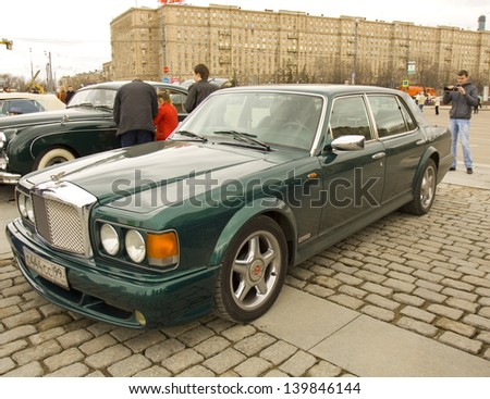 MOSCOW - APRIL 21: retro car Bentley on rally of classical cars on Poklonnaya hill,  April 21, 2013, in town Moscow, Russia, unidentified people looking at rally.