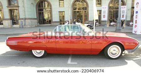 MOSCOW - APRIL 27, 2014: retro car Ford Thunderbird of 1961 year on rally of classical cars, organized by Russian Club of Classical Autocars on Theatre square.  - stock photo