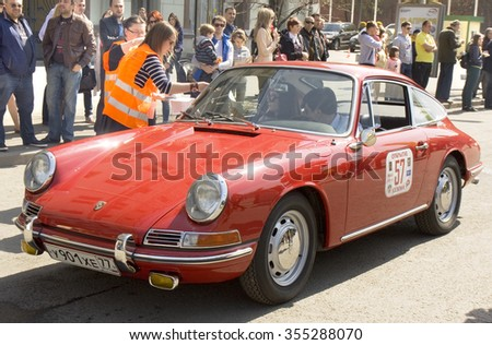 MOSCOW - APRIL 27, 2014: retro car porsche on rally of classical cars, organized by Russian Club of Classical Autocars on Theatre square.