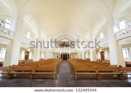 MOSCOW - APRIL 11: Rows of benches and organ in Evangelical Lutheran Cathedral of Sts. Peter and Paul on April 11, 2012 in Moscow, Russia. - stock photo