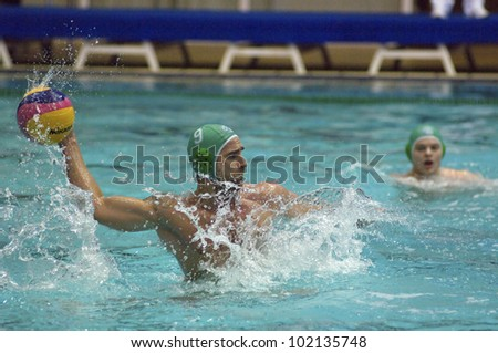 MOSCOW - APRIL  6: Stepanyuk Konstantin atack during a game Dynamo(white) vs Sintez (green) of waterpolo Championship of Russia on April 6, 2012 Moscow, Russia - stock photo