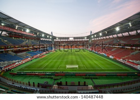 MOSCOW - AUG 15: Empty stadium with footboll field after the game in the evening on August 15, 2012 in Moscow, Russia.