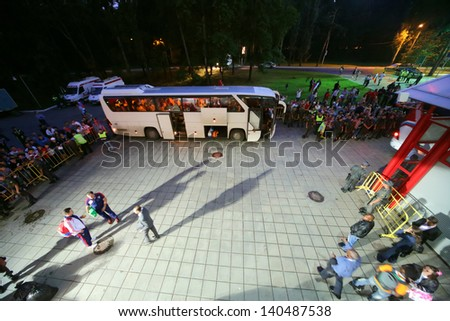 MOSCOW - AUG 15: Fans are watching as players get on bus after match between Russia national team and Ivory Coast at Lokomotiv Stadium, Aug 15, 2012, Moscow, Russia. The game ended with the score 1:1 - stock photo