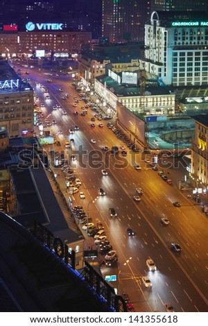 MOSCOW - AUG 4: Night traffic at intersection of Novinsky Boulevard and Smolenskaya Square, August 4, 2012, Moscow, Russia. Smolenskaya Square - street in Central Administrative District of Moscow.