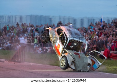 MOSCOW - AUG 25: The car landed after jumping from the springboard on Festival of art and film stunt Prometheus in Tushino on August 25, 2012 in Moscow, Russia. The festival was organized in 1998. - stock photo