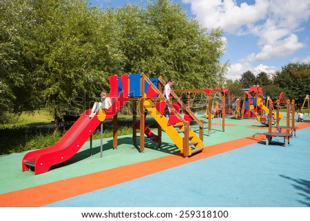 MOSCOW - AUGUST 2: Children playing in a playground in the Heritage Village Park in Bibirevo district on August 2, 2013 in Moscow. Bibirevo is district of North-Eastern part of Moscow, Russia.
