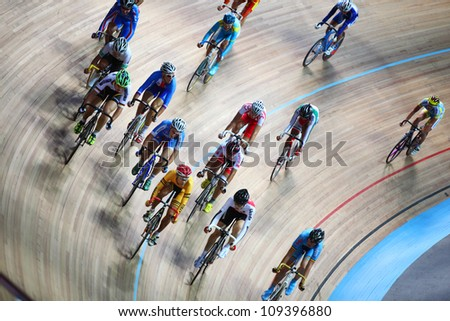 MOSCOW - AUGUST 19: Competitors at UCI juniors track world championships on August 19, 2011 in Moscow, Russia. - stock photo