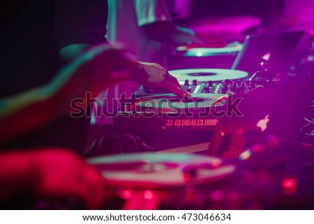 MOSCOW - 7 AUGUST, 2016 : Invisibl Skratch Piklz (DJ Q-Bert, DJ D-Styles, DJ Shortkut) at Russian DMC DJ.Hands of disc jockey play music show on stage,scratch vinyl records on turntable record player