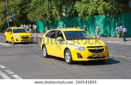 MOSCOW - AUGUST 03: Two yellow taxi car in Zhukov Street on August 3, 2014 in Moscow. - stock photo