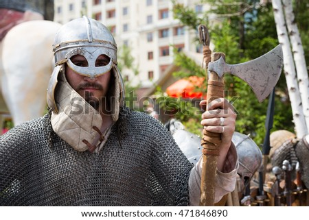 MOSCOW - CIRCA JUNE, 2016: Man with an iron ax in the dress of a Russian soldier of the Middle Ages to the celebration of the Day of Russia in Moscow on June 12, 2016.