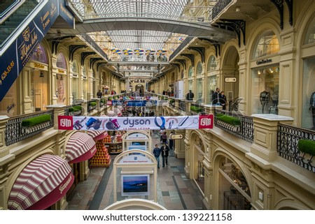 MOSCOW-CIRCA MAR 2013:GUM Shopping Mall in the Red Square in Moscow, circa March 2013. With a population of more than 11 million people is one the largest cities in the world and a popular destination - stock photo
