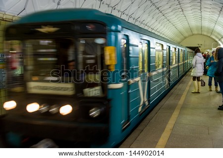 MOSCOW - CIRCA MARCH 2013: Train in Sportivnaya Metro Station circa March 2013. With a population of more than 11 million people is one the largest cities in the world and a popular destination. - stock photo