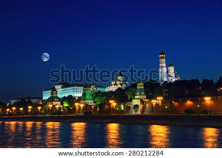 Moscow city Kremlin at night, Russia. Dark sky with the full moon, illumination. Elements of this image furnished by NASA. - stock photo