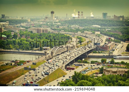 Moscow - city landscape. Road with cars at rush hour. The Third Ring Road. Life of the big city. Moscow river. City Attractions. Photo toned in yellow - stock photo